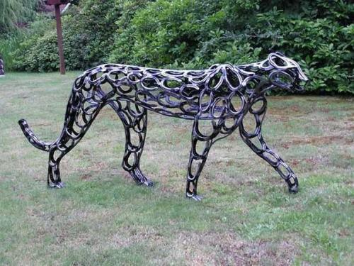 Cheetah sculpture made with horseshoes