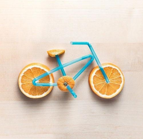 Bicycle made out of an orange and straws